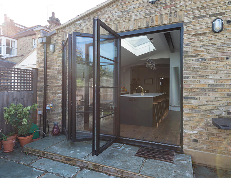 An open black aluminium bifold doors Essex