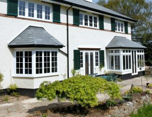 Two white aluminium bay windows